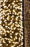 Gold bokeh lights defocused. abstract background.  Royalty Free Stock Image