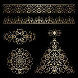 Gold borders and swirly design elements on black Royalty Free Stock Images