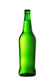 Gold bottle of beer with drops on white background Stock Photos