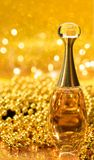 Gold bottle parfume close-up dior bokeh background glitter macro light beautiful abstract blur texture. Celebrity still-life luxury royalty free stock photos
