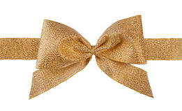 Gold bow. Gold gift brocade ribbon bow on white background Royalty Free Stock Photos