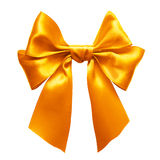 Gold bow. Gold satin gift bow. Ribbon. Isolated on white Stock Image
