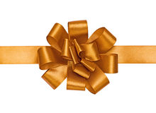 Gold bow. On the white Royalty Free Stock Images