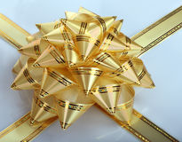 Gold bow. Gold bow with ribbons on the box Stock Image