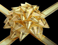 Gold bow. Gold bow with ribbons.Isolated Stock Photography
