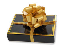 Gold bow and box Royalty Free Stock Photos