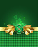 Gold bow with clover Stock Image