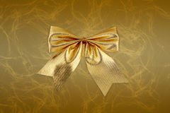 Gold bow decoration Royalty Free Stock Image