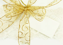 Gold Bow with Gift Tag Royalty Free Stock Photo