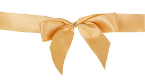 Gold bow. Isolated on white background Stock Images