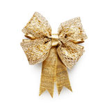 Gold bow. Gold ribbon bow isolated on white background clipping path included Stock Photo
