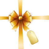 Gold bow with tag Stock Photography