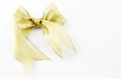 Gold bow on white rectangular background Royalty Free Stock Image