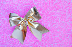 Gold Bowknot On A Pink Background Royalty Free Stock Photo