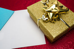 A Gold Box with Bow and Card Stock Images