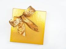Gold Box & Bow Royalty Free Stock Photos