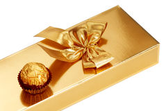 Gold box with chocolate royalty free stock image