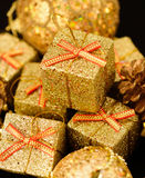 Gold box with gifts. Royalty Free Stock Image