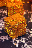 Gold box with gifts Royalty Free Stock Images