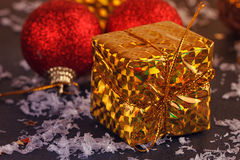 Gold box with gifts Stock Photos