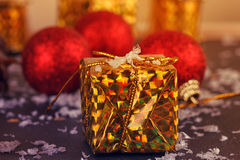 Gold box with gifts Stock Photography