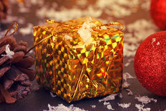 Gold box with gifts Stock Image