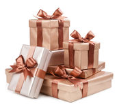 Gold box with gifts and brown bow.  Stock Photos