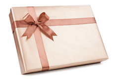 Gold box with gifts and brown bow Royalty Free Stock Photo