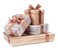 Gold box with gifts and brown bow Royalty Free Stock Photos