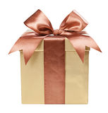 Gold box with gifts and brown bow Royalty Free Stock Images