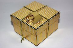 Gold box for gifts Royalty Free Stock Images