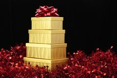 Gold Boxes Red Bow Red Garland Stock Photos