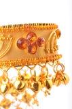 Gold bracelet. 22 karat gold bracelet standing on isolated background stock photos