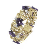 Gold Bracelet. Gold bangle bracelets with jeweled flowers and diamond accents Royalty Free Stock Image