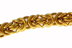 Gold bracelet. On white background Stock Photo
