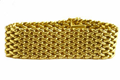 Gold bracelet. On the white background Royalty Free Stock Images