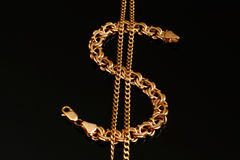 A gold bracelet and a chain Stock Photo