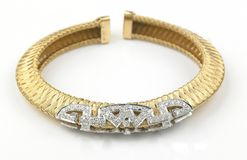 Gold bracelet with diamonds. In white background Royalty Free Stock Images
