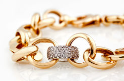 Gold bracelet with diamonds. Close up  on white Royalty Free Stock Image
