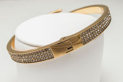 Gold bracelet with diamonds. In silver box isolated Stock Photography