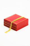 Gold Bracelet and gifts box Royalty Free Stock Photography
