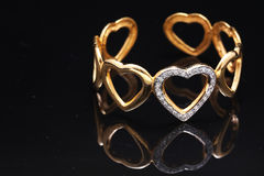 gold bracelet with hearts Stock Images