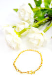 Gold bracelet isolated on white with flowers Royalty Free Stock Image