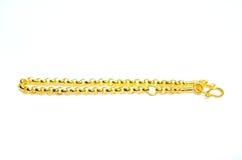 Gold bracelet isolated on white Royalty Free Stock Photography