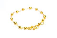Gold bracelet isolated on white Stock Photo