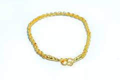 Gold bracelet isolated on white Stock Photos