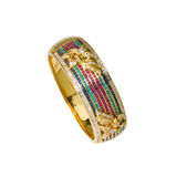 Gold bracelet with multicolor gems Royalty Free Stock Images