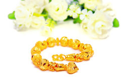 Gold bracelet 96.5 percent Thai gold grade with flowers and uniq Stock Image