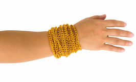 Gold bracelet at wearing ladys arm. Isolated on white background Stock Photos