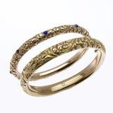 Gold Bracelets. Gold bangle bracelets with sapphires Stock Photo